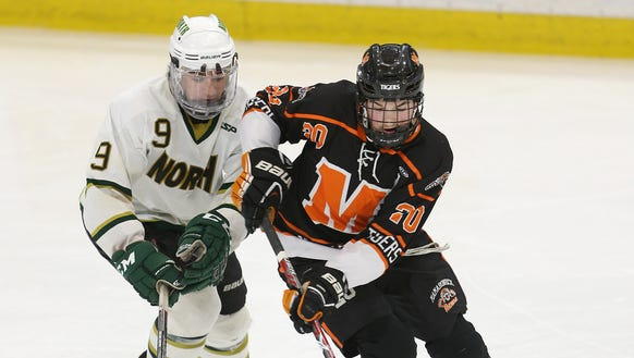 Mamaroneck's Will Payne (20) control the puck away
