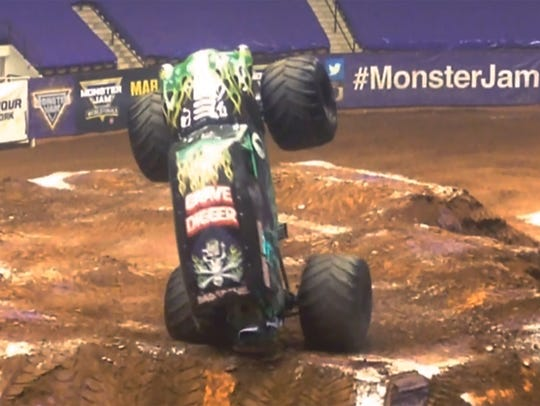 Pablo Huffaker goes vertical while driving Grave Digger