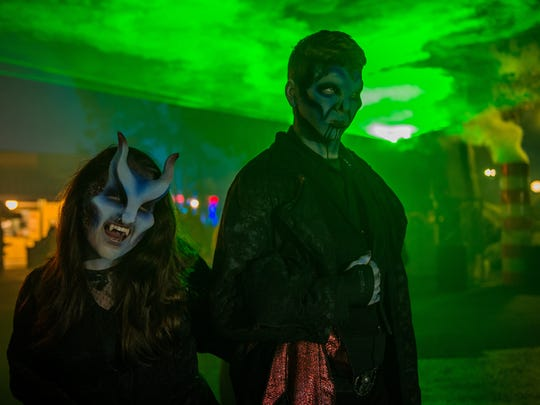 Guests to Fright Fest at Six Flags Great Adventure in Jackson can stroll through the park's Demon District.