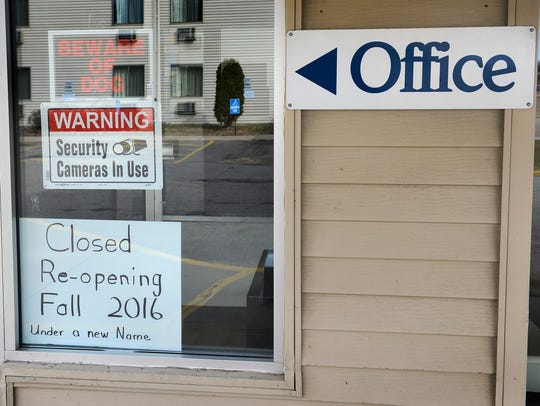 A sign by the former Waite Park Motel 6's office Thursday.
