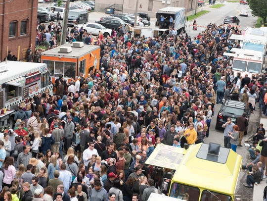 The street view on Saturday, May 30, 2015, during the Food Truck Throwdown held at the Des Moines Social Club.