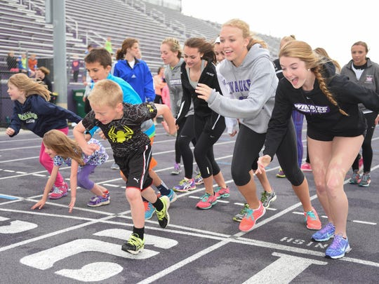 Kids of all ages race around the track during Waukee Healthy Kids Day held at Waukee Stadium on May 2, 2015.