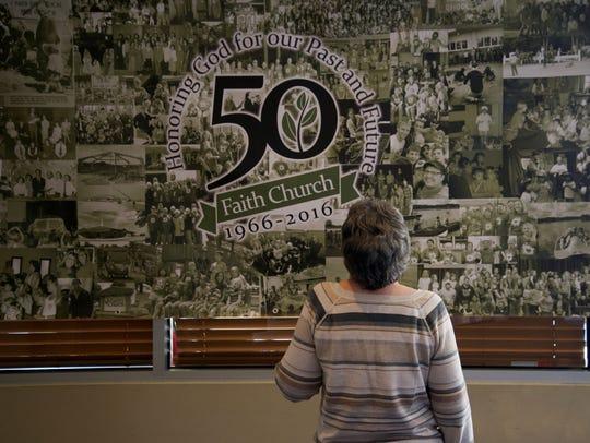 A Faith Church member looks over a compilation of photos