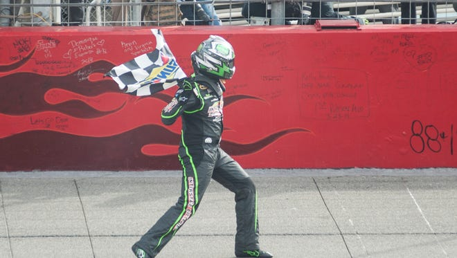 Kyle Busch celebrates after winning the 2014 Auto Club 400 at Fontana, Calif.