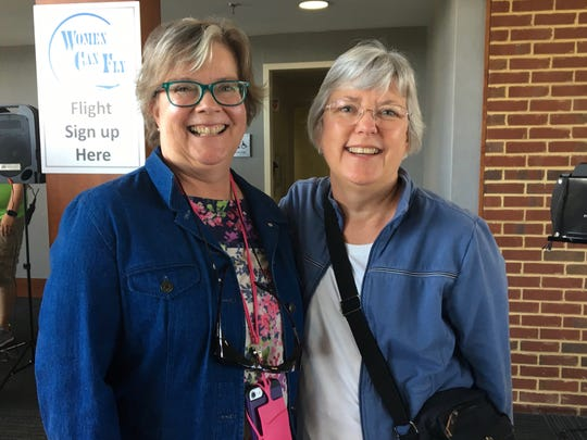 Friends Pamela Hamilton and Bonnie Burt, of Elkton, attend Women Can Fly on Saturday, July 7, 2018, at Shenandoah Valley Regional Airport in Weyers Cave. Hamilton, who says she's not the bravest flyer, thinks it's a great chance to do something out of her comfort zone.