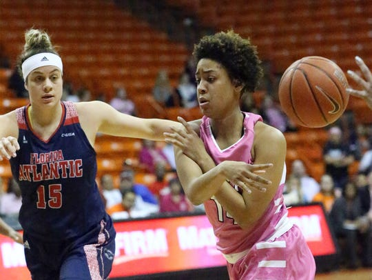 UTEP's Najala Howell flips the ball to a teammate while