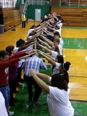 Gallatin High School students participate in an activity called Cross the Line as part of Move2Stand (M2S), a school-wide bullying and harassment program that trains students to proactively demonstrate care/compassion/empathy for others.