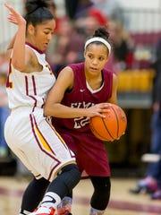 Elmira's Anasah DeMember looks for room to dribble last season against Ithaca.