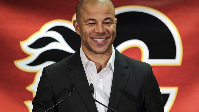 Former Calgary Flames hockey team captain Jarome Iginla announces his retirement from the NHL, after playing 20 seasons, at a news conference in Calgary, Alberta, Monday, July 30, 2018. Iginla, the first Black player to lead the NHL in points and goals and to win an Olympic gold medal, headlines the Hockey Hall of Fame's 2020 induction class.