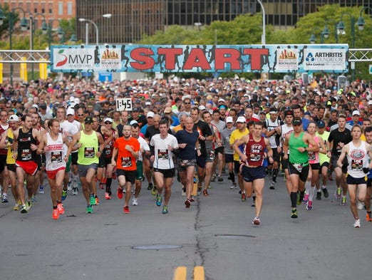 Runners hit the course at the start of the 2013 Rochester Marathon Sunday.