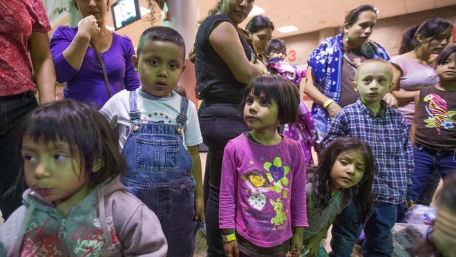 Migrants are released from ICE custody at a Greyhound Bus station in Phoenix in May. A surge of unaccompanied minors from Central American countries are crossing the Texas border. President Obama is asking for $3.7 billion to address the ongoing crisis. <137>with the U.S. scrambling to deal with the growing crisis.The Border Patrol says about 400 migrants were flown from Texas to Arizona because of surge in migrants being apprehended in Texas. This group was from Texas and Georgia.<137>