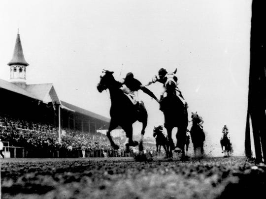 FILE - In this May 1933 file photo, Herb Fisher, left, on Head Play, and Don Meade on Brokers Tip, feud near the finish of the Kentucky Derby horse race in Louisville, Ky. (Wallace Lowry/The Courier-Journal via AP)