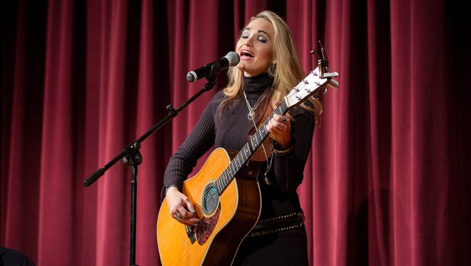 "Country music star Bri Bagwell performs with her two brothers at the New Mexico Farm & Ranch Museum to mark the premiere of her new music video, ""Las Cruces"", that celebrates the people, landscape and traditions of the city."