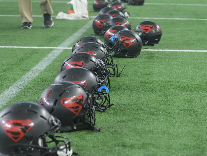 Strawn helmets are lined up in a row as players celebrate