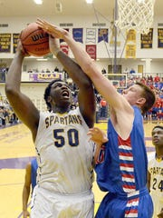 Caleb Swanigan of Homestead is fouled on the shot by Erik Bowen of Kokomo.