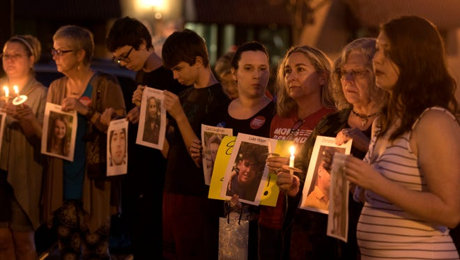 People gather at Garden St. and Palafox St. Sunday, February 18, 2018 for the Candlelight Vigil for Parkland Shooting Victims. The vigil was hosted by Mom's demand Action, Indivisible Northwest Florida and Progressives Northwest Florida.