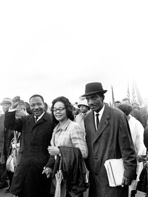 The Rev. Martin Luther King Jr., and his wife, Coretta King, lead off the final day for the Selma to Montgomery march on March 25, 1965. Thousands of civil rights marchers joined in the walk, which began in Selma on March 21, demanding voter registration rights for blacks. The Rev. F.D. Reese, of Selma, is at right.