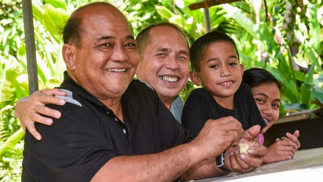 The Viloria-Palomo family in the garden of their Toto home on Thursday, June 15, 2017. From left, Alejandro Viloria, Simeon Palomo, Vincent Viloria-Palomo and Jolie Viloria-Palomo.