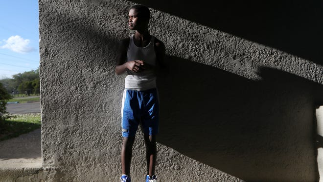 Aziz Ferguson, a 15-year-old Nims Middle School student, stands for a portrait at the Lincoln Center Boxing Club where he trains for two hours a day, four days a week, often running from his home and back, around four miles each way.