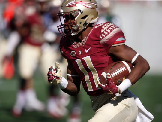 FSU's George Campbell runs the ball after a catch during