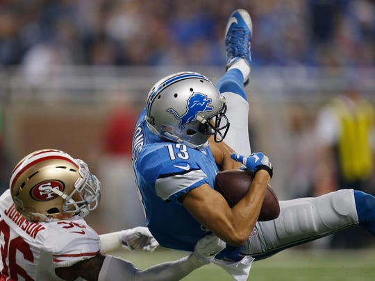 """Jones holds on to the ball while defended by San Francisco's Dontae Johnson. Coach Jim Caldwell described Jones' return as """"difficult."""""""