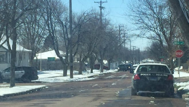 Police investigate the report of a shooting near 13th Street and Willow Avenue on Thursday.