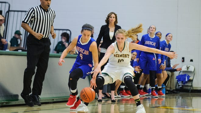 Catamount forward Hanna Crymble (10) and American's Emily Kinneston (4) battle for the loose ball during the women's basketball game between the American Eagles and the Vermont Catamounts in the first game of the TD Bank Classic at Patrick Gym on Friday.