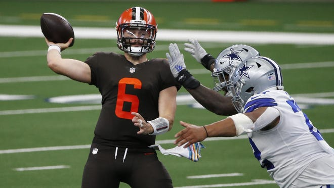 Cleveland Browns quarterback Baker Mayfield throws a pass under pressure from the Dallas Cowboys defense during the Browns' 49-38 win Sunday in Arlington. The Austin native threw for two touchdowns in the victory.