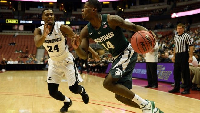 Michigan State guard Eron Harris drives the ball past Providence's Kyron Cartwright (24) during the second half of MSU's 77-64 win in the final of the Wooden Legacy tournament in Anaheim, Calif. Harris finished with 12 points.