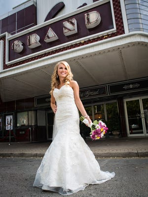 Mikyala's mermaid gown cost $210.54 and her bouquet by Delmar florists was $63. Sept. 28, 2014