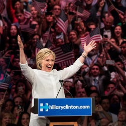Clinton gestures to the crowd at the start of her remarks during a primary night rally at the Duggal Greenhouse in the Brooklyn Navy Yard on June 7, 2016.