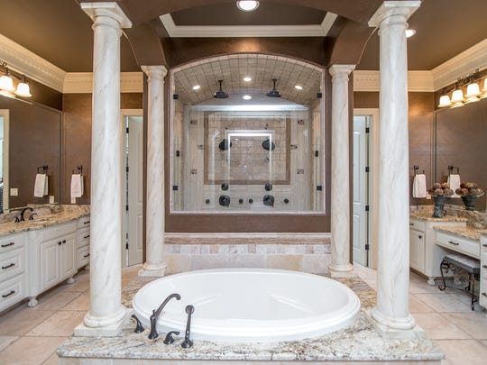 The master suite bathroom may elicit visions of a Grecian