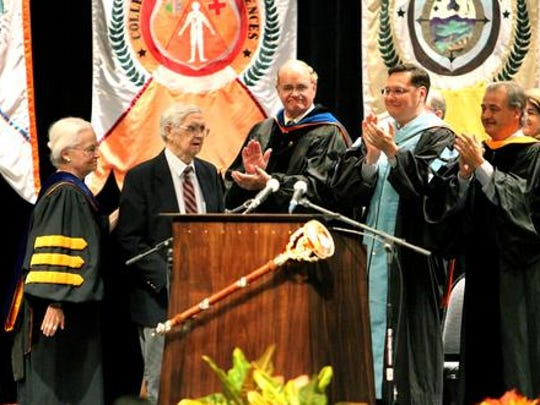 UTEP president Diana Natalicio, left, recognized John H. Haddox, second from left, for his 55 years of service to the university during the 2012 Fall Convocation at Magoffin Auditorium on campus. Haddox is a faculty member in the Department of Philosophy.