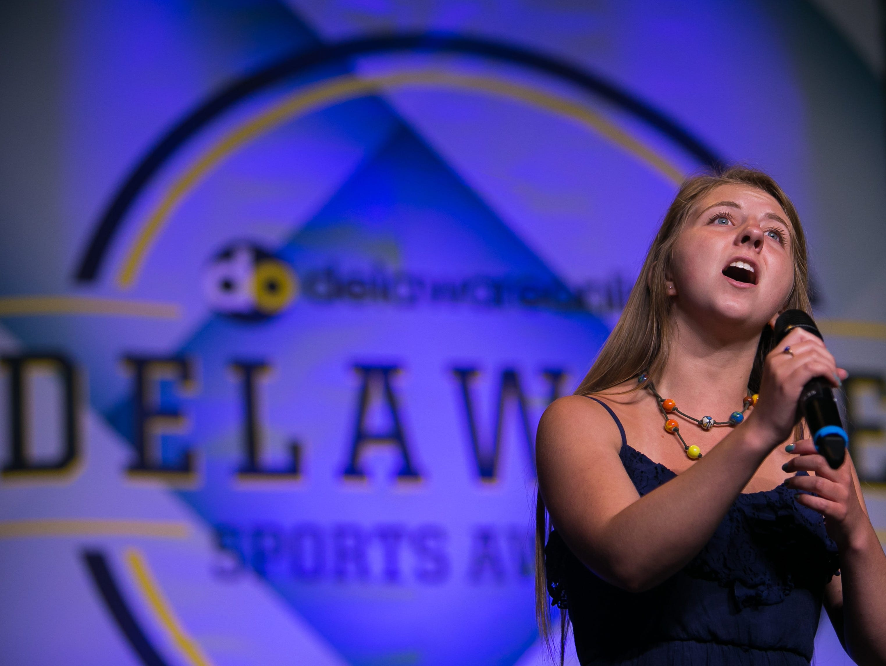 Hannah Scarborough sings the National Anthem at the Delaware Sports Awards.