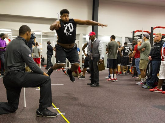 Ex-Cajuns offensive lineman Mykhael Quave broad jumps during UL's Pro Day for NFL scouts on Wednesday.