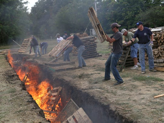 Volunteers came to the Shiloh Fire Department in this News Journal file photo to help prepare for the 50th annual Ox Roast. 9,200 pounds of sirloin tip roast was prepared to go into a ash bed that is 90 feet long and six feet deep, where it will cook for 11-12 hours.