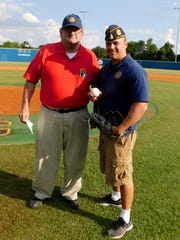 Ken Thibodeaux and James Wheeler getsready to throw out the first pitch to kick off the American Legion baseball season in Opelousas.
