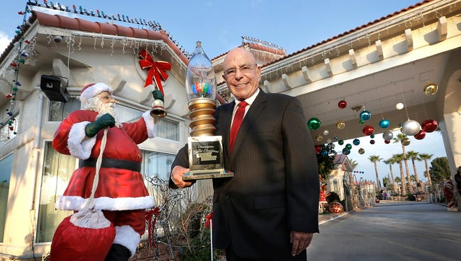 2014 - Fred Loya stands in front of his Christmas creation for which he won a national award, The Great Christmas Light Fight. The home at 12001 Paseo de Oro in east El Paso has become a must-see at Christmas time.