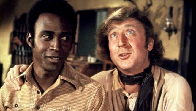"Cleavon Little (left) and Gene Wilder star in Mel Brooks' 1974 comedy ""Blazing Saddles."""