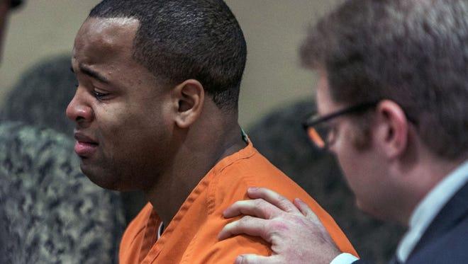 Defense attorney Trevor Hill consoles Orlando Bradford during his sentencing hearing Monday.