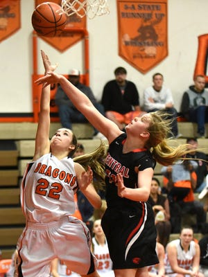Dallas's Taylor Fennell tries to get around Central's Reba Hoffman as the Dragons defeat the Panthers in a Mid-Willamette Conference game on Wednesday, Feb. 11, 2015, in Dallas.