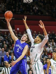 Sayreville's Jayson Demild (5) shoots under coverage from St. Joseph's Malachi Walker (14) during their GMC Tournament final on Friday at Rutgers.