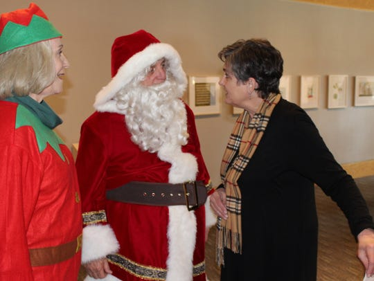 Santa engages in an animated conversation with Betty