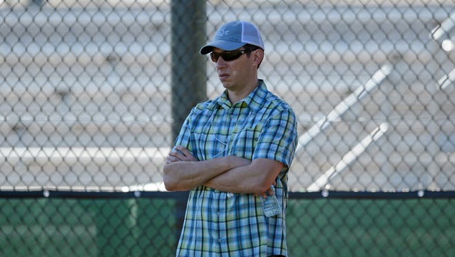 Texas Rangers general manager Jon Daniels looks on during a workout during spring training.