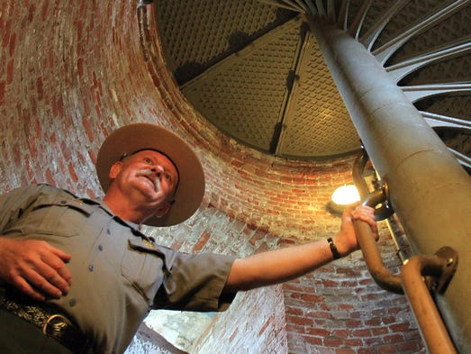 ASB 0611Sandy Hook Lighthouse  John Harlan Warren, External Affairs Officer, leads the way, 95 steps, to the top of the lighthouse. Gateway National Recreation Area, Sandy Hook Unit, celebrate's Sandy Hook Lighthouse's 250th Anniversary this coming Saturday with activities and events for everyone. Today, June 11, 2014, marks the actual 250th anniversary of the lighthouse. Staff Photographer/Mary Frank