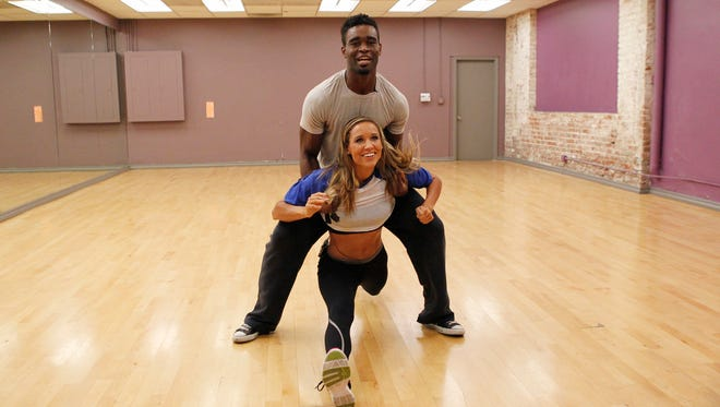 "Lolo Jones and her partner, Keo Motsepe, rehearse for ""Dancing With the Stars."""