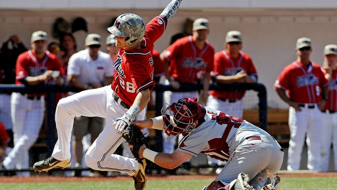 Arkansas catcher Jake Wise tags out Mississippi's Brantley Bell (28) at home plate during an NCAA college baseball game at Oxford-University Stadium in Oxford, Miss., on Saturday, May 3, 2014. (AP Photo/The Daily Mississippian, Thomas Graning)