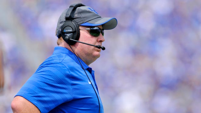 UK Coach Mark Stoops looks on from the sideline against UT Martin, Saturday, Aug. 30, 2014 at Commonwealth Stadium in Lexington. Photo by Tim Webb, Special to the CJ