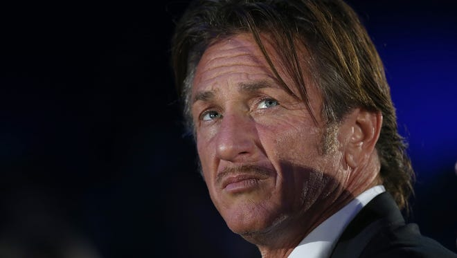 Actor Sean Penn listens to a keynote address by Salesforce CEO Marc Benioff at the 2013 Dreamforce conference on Nov. 19 in San Francisco.
