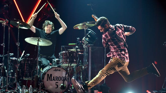 Matt Flynn, left, and Adam Levine of Maroon 5 perform on Aug. 26 in Burbank, Calif.
